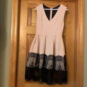 Cocktail dress. Light pink with black lace.